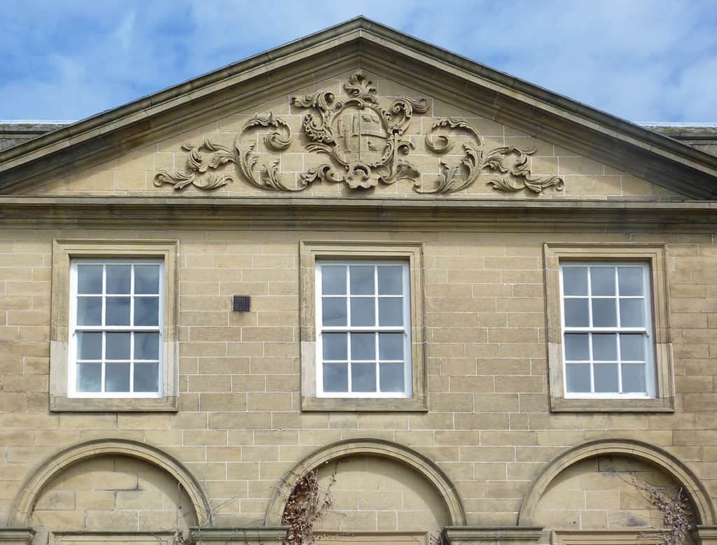 Fenham-Hall-1748-by-D.-Garrett-with-south-tympanum-carved-by-James-Guthrie-for-John-Ord-mayor-of-Newcastle